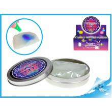 Chytrá hmota v plechovce měnící barvu pod UV světlem s UV klíčenkou